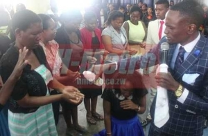 End Time Pastor Equates Power of Jik to Blood of Jesus as He Washes Members